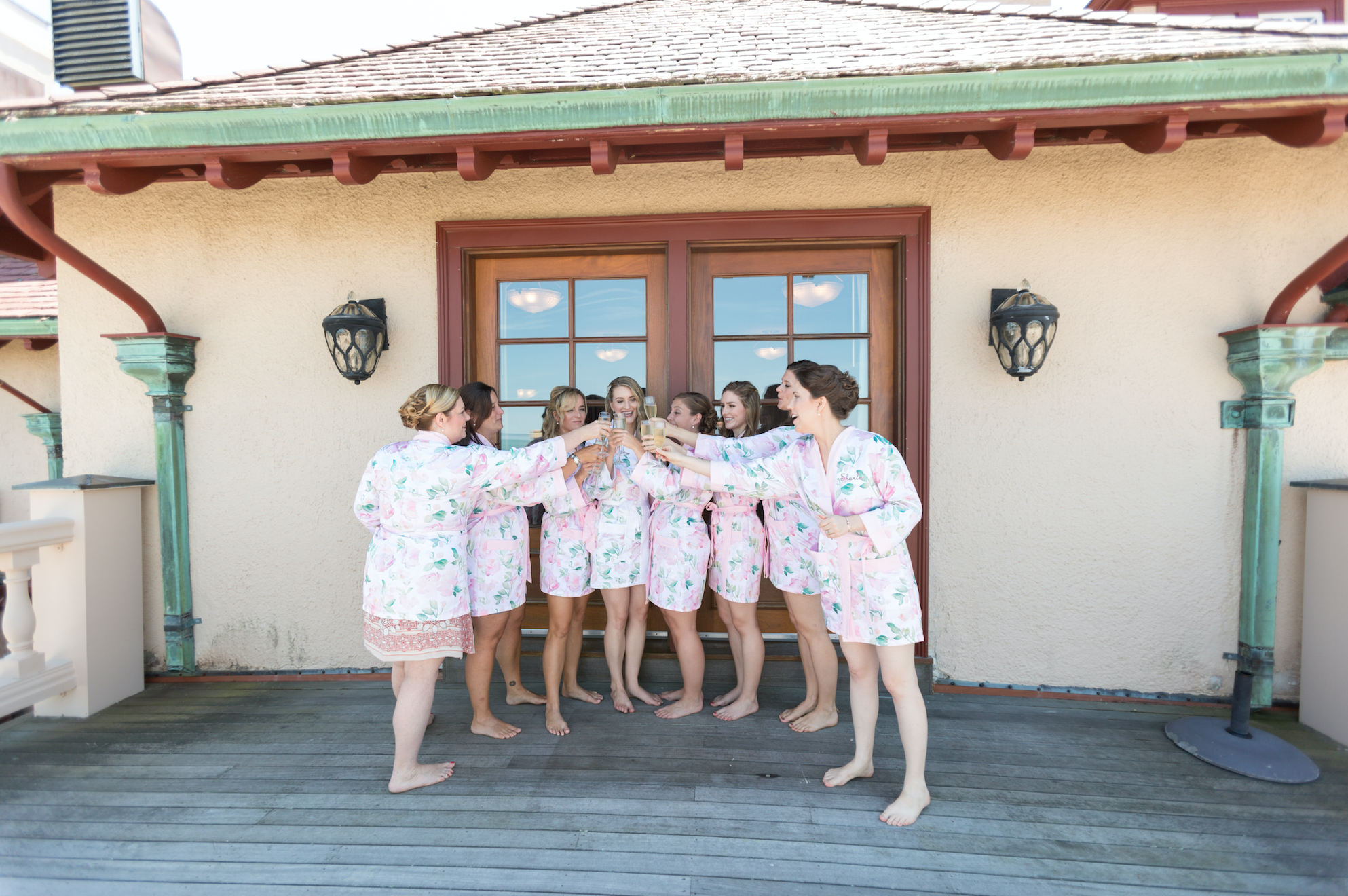 Champagne toast with bridesmaids