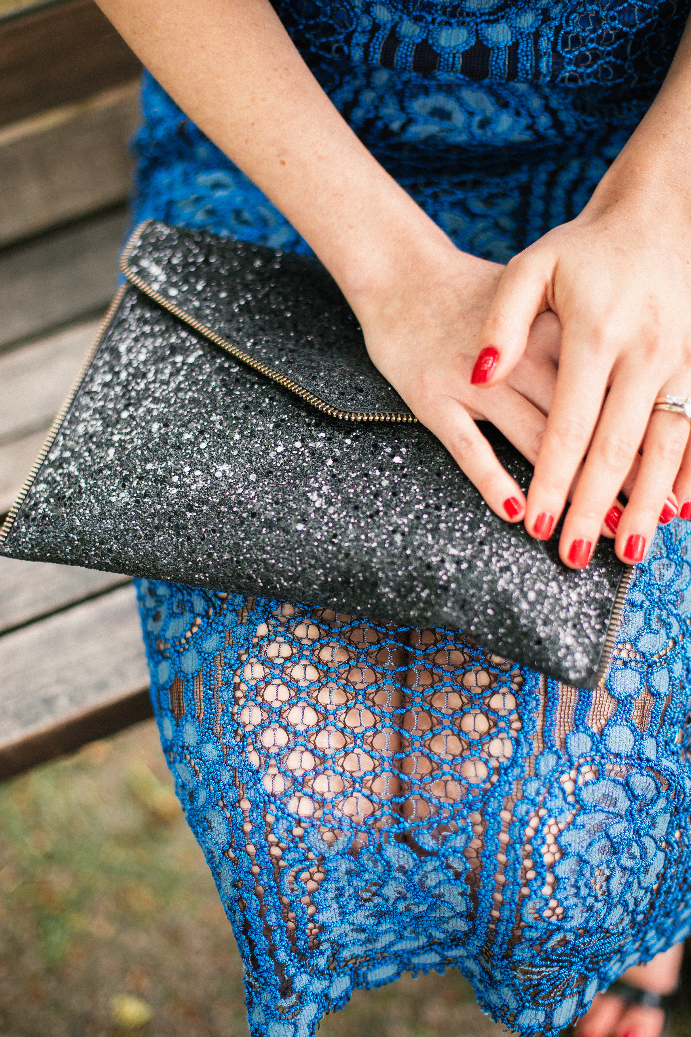 Lace dress and clutch details